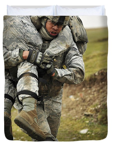 A Soldier Transports A Fellow Wounded Duvet Cover by Stocktrek Images