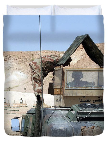 A Soldiier Instructs An Iraqi Army Duvet Cover by Stocktrek Images