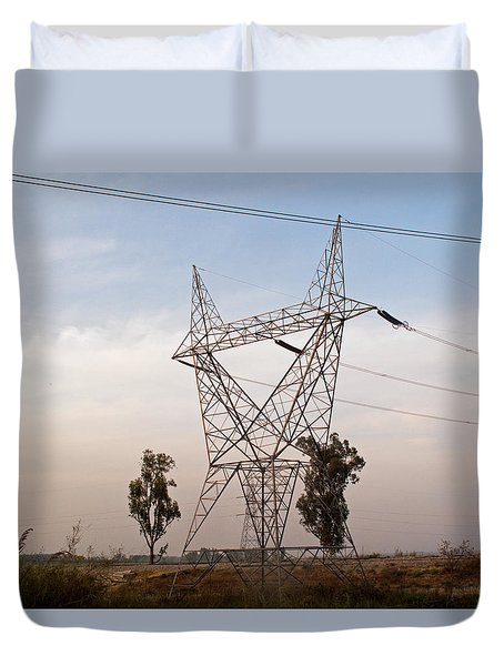 A Transmission Tower Carrying Electric Lines In The Countryside Duvet Cover by Ashish Agarwal