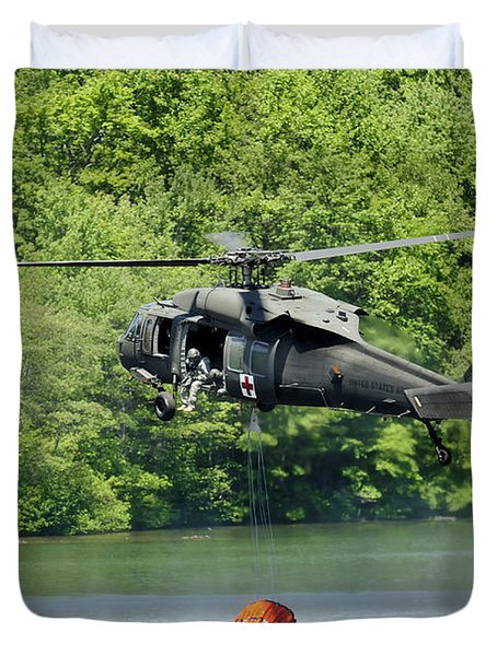 A Uh-60 Blackhawk Helicopter Fills Duvet Cover by Stocktrek Images