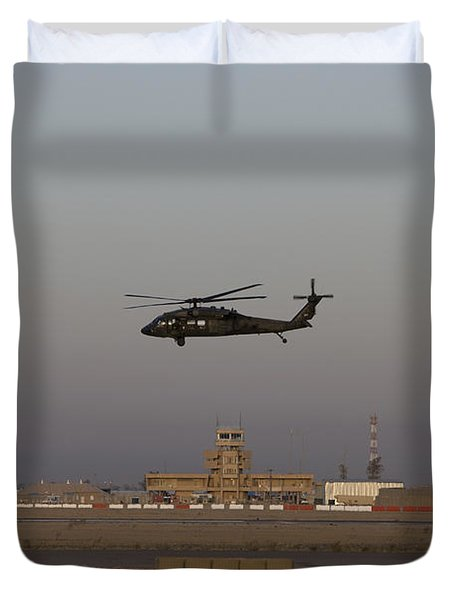 A Uh-60 Blackhawk Helicopter Flies Duvet Cover by Terry Moore