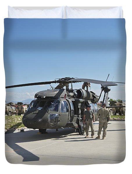 A Uh-60l Blackhawk Parked On Its Pad Duvet Cover by Terry Moore