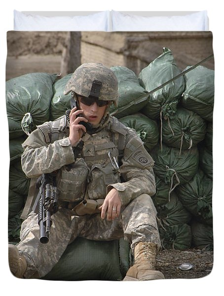 A U.s. Army Soldier Talks On A Radio Duvet Cover by Stocktrek Images