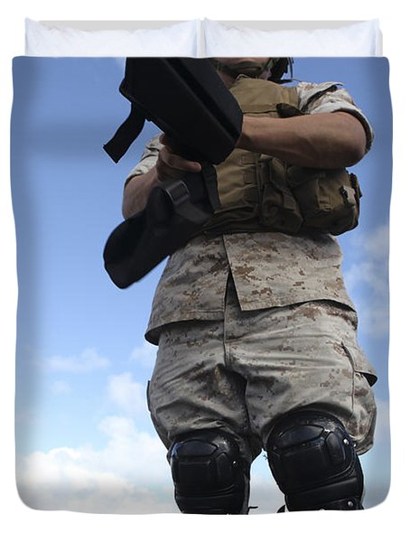A U.s. Marine Dons Riot Gear For Drills Duvet Cover by Stocktrek Images