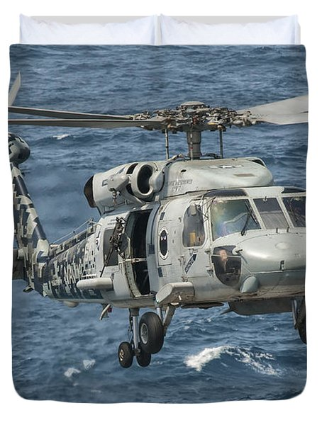 A Us Navy Sh-60f Seahawk Flying Duvet Cover by Giovanni Colla