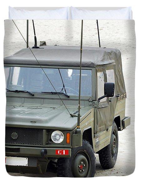 A Vw Iltis Jeep Of A Unit Of Belgian Duvet Cover by Luc De Jaeger