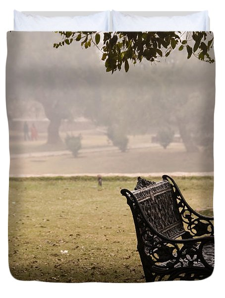 A Wrought Iron Black Metal Bench Under A Tree In The Qutub Minar Compound Duvet Cover by Ashish Agarwal