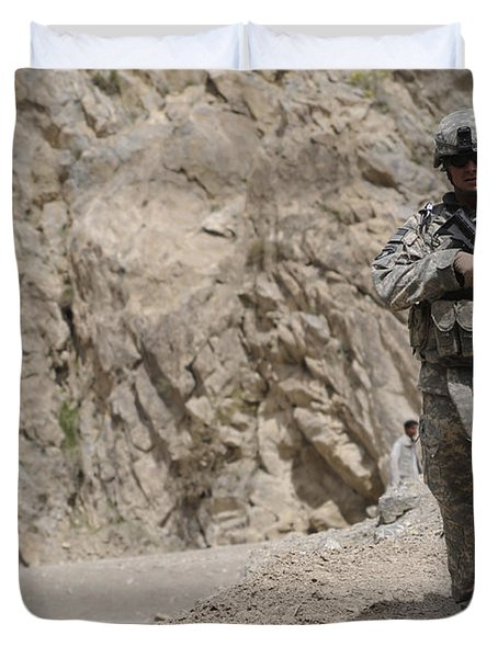 Airman Provides Security During Combat Duvet Cover by Stocktrek Images