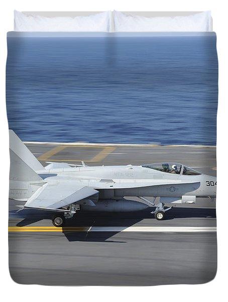 An Fa-18c Hornet Lands Aboard Uss Duvet Cover by Stocktrek Images