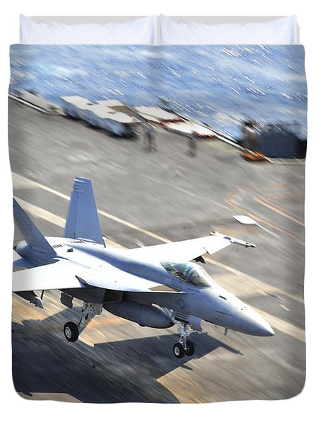 An Fa-18e Super Hornet Lands Aboard Duvet Cover by Stocktrek Images