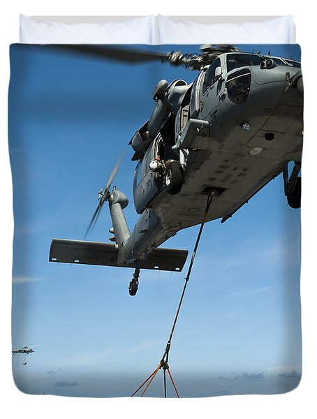 An Mh-60s Sea Hawk Helicopter Lowers Duvet Cover by Stocktrek Images