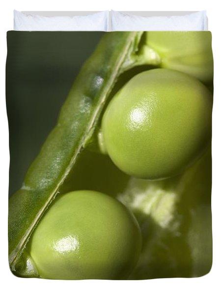 An Opened Green Pea Pod Alberta, Canada Duvet Cover by Michael Interisano