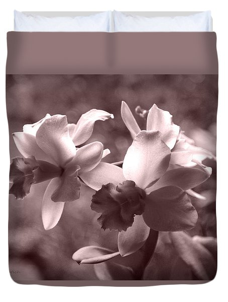 Duvet Cover featuring the photograph An Orchid Dream by Kerri Ligatich
