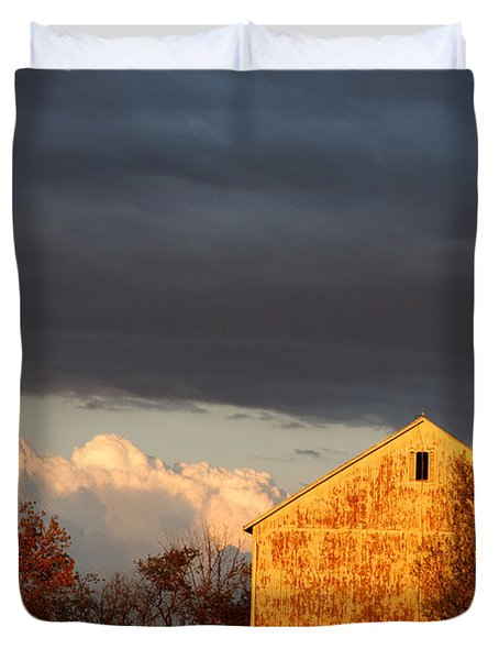 Duvet Cover featuring the photograph Autumn Glow With Storm Clouds by Karen Lee Ensley