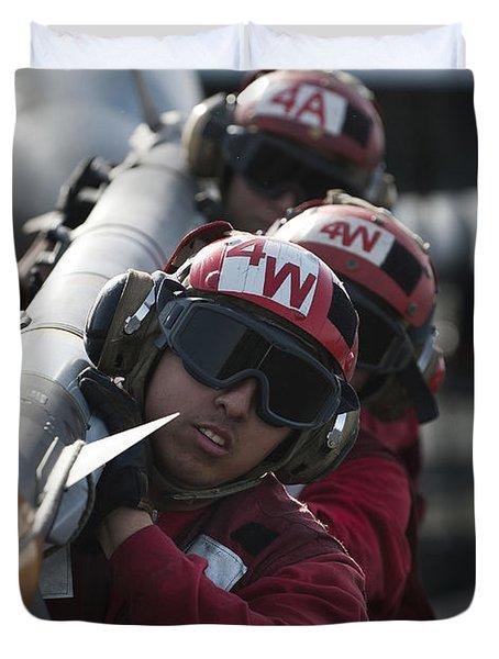 Aviation Ordnancemen Carry An Duvet Cover by Stocktrek Images