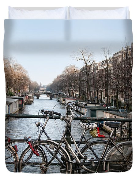Duvet Cover featuring the digital art Bikes On The Canal In Amsterdam by Carol Ailles