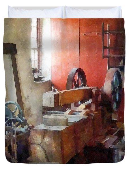 Blacksmith Shop Near Windows Duvet Cover by Susan Savad