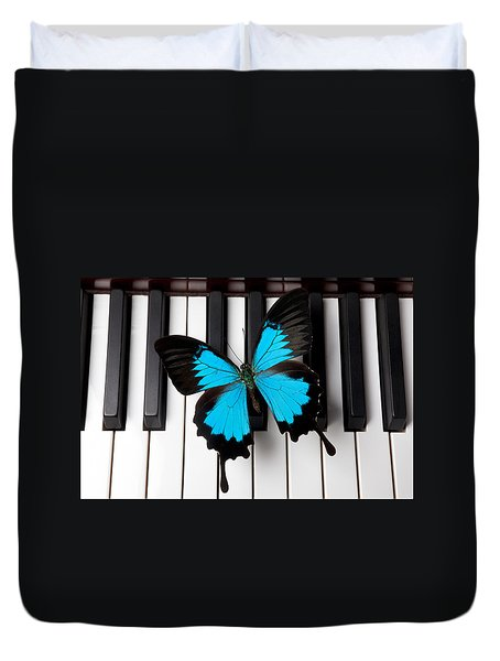 Blue Butterfly On Piano Keys Duvet Cover by Garry Gay