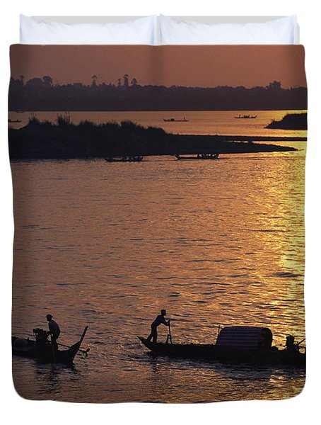 Boats Silhouetted On The Mekong River Duvet Cover by Steve Raymer