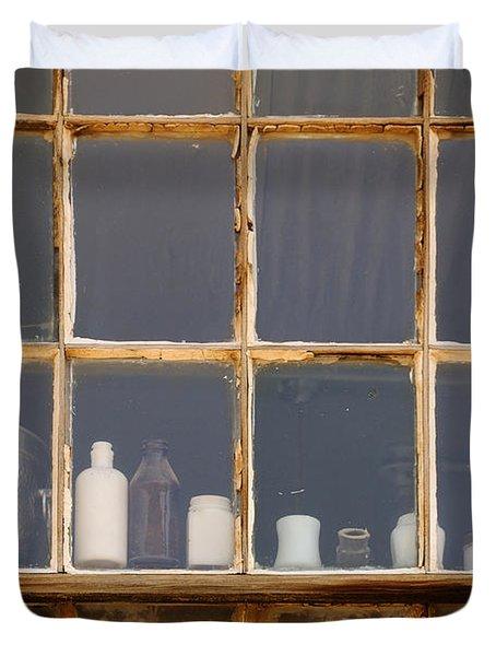 Bottles In The Window Duvet Cover by Vivian Christopher