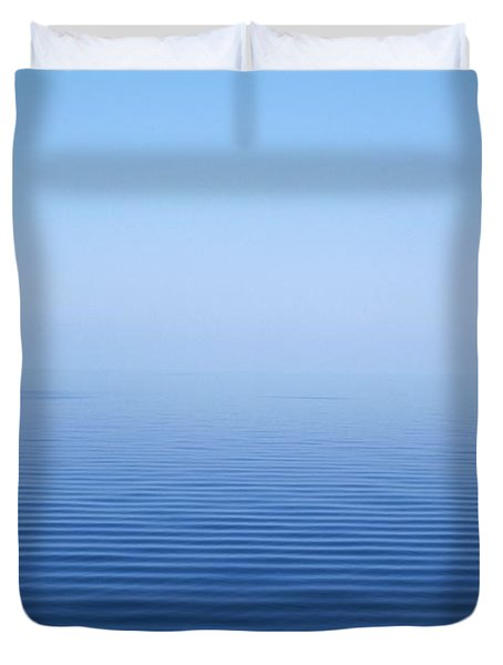 Calm Blue Water Disappearing Into Duvet Cover by Axiom Photographic