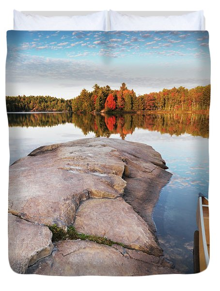 Canoe At A Rocky Shore Autumn Nature Scenery Duvet Cover by Oleksiy Maksymenko