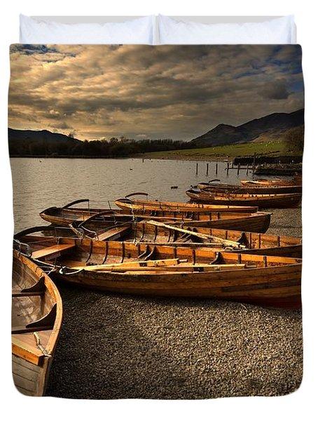 Canoes On The Shore, Keswick, Cumbria Duvet Cover by John Short