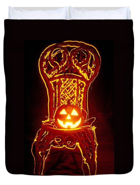 Carved Smiling Pumpkin On Chair Duvet Cover by Garry Gay
