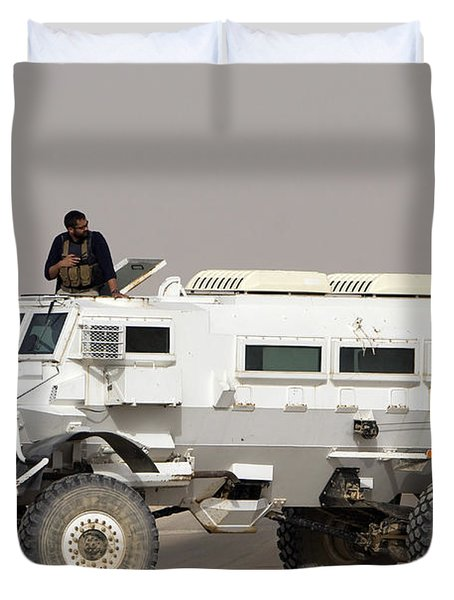 Casper Armored Vehicle Blocks The Road Duvet Cover by Terry Moore