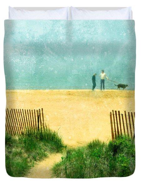 Couple Walking Dog On Beach Duvet Cover by Jill Battaglia
