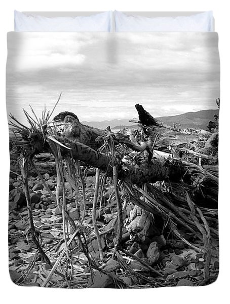 Duvet Cover featuring the photograph Driftwood And Rocks by Chriss Pagani