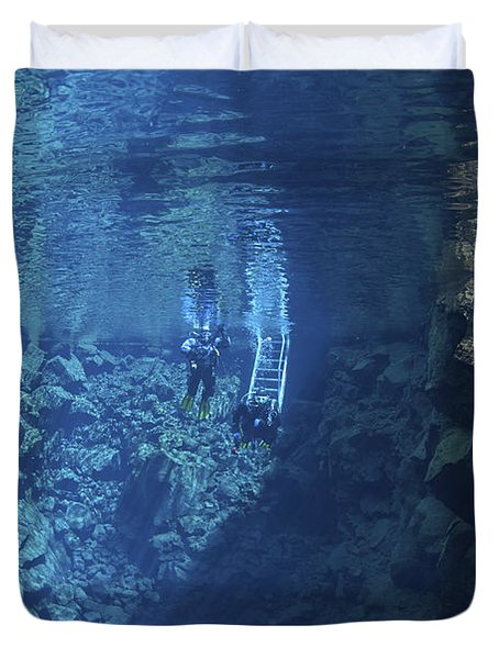 Dry Suit Divers Entering The Gin Clear Duvet Cover by Mathieu Meur