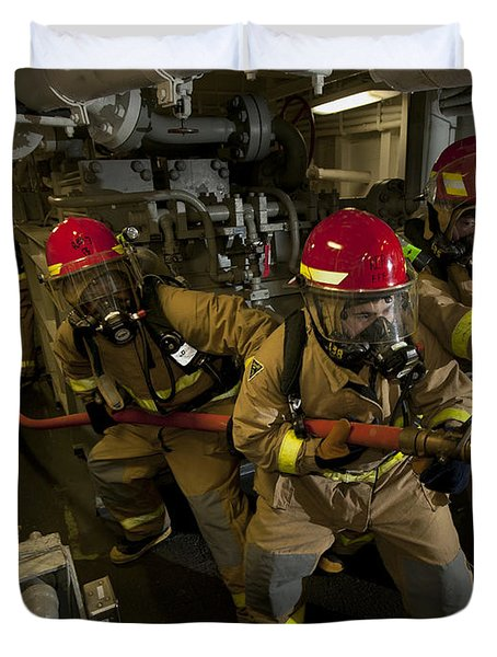 Firemen Combat A Simulated Fire Aboard Duvet Cover by Stocktrek Images