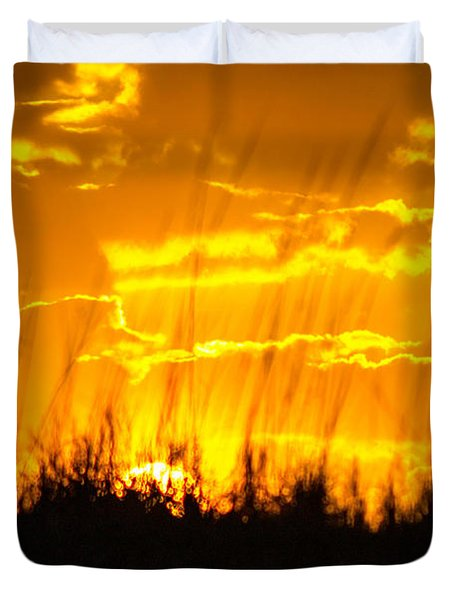Duvet Cover featuring the photograph Firey Sunset by Shannon Harrington