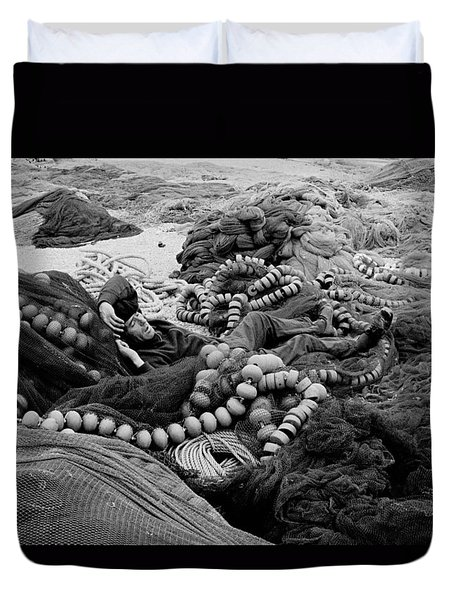 Duvet Cover featuring the photograph Fisherman Sleeping On A Huge Array Of Nets by Tom Wurl