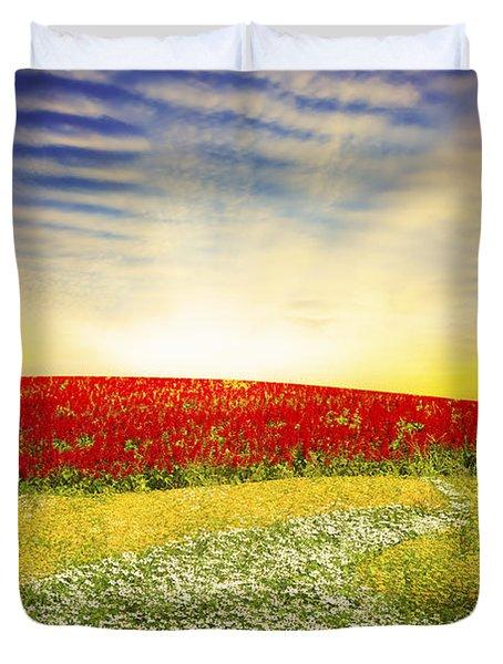 Floral Field On Sunset Duvet Cover by Setsiri Silapasuwanchai