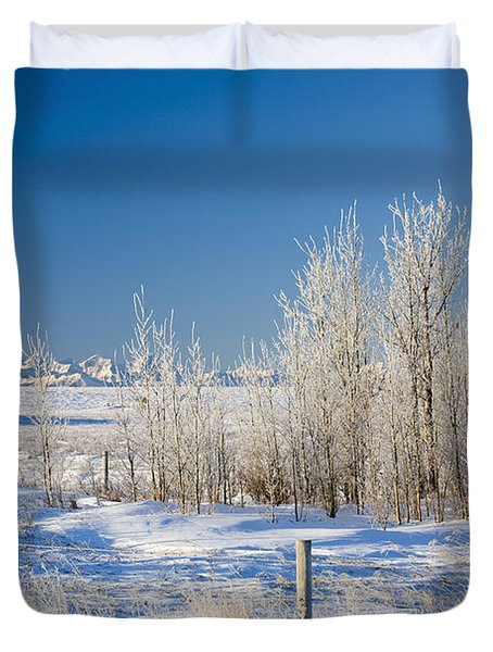 Frost-covered Trees In Snowy Field Duvet Cover by Michael Interisano