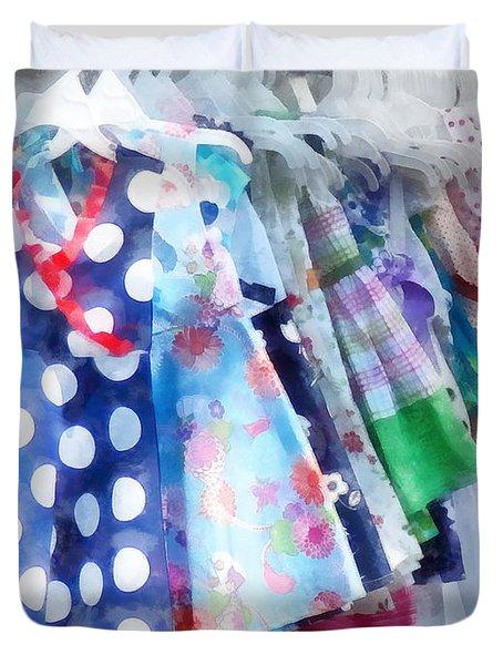 Girl's Dresses At Street Fair Duvet Cover by Susan Savad