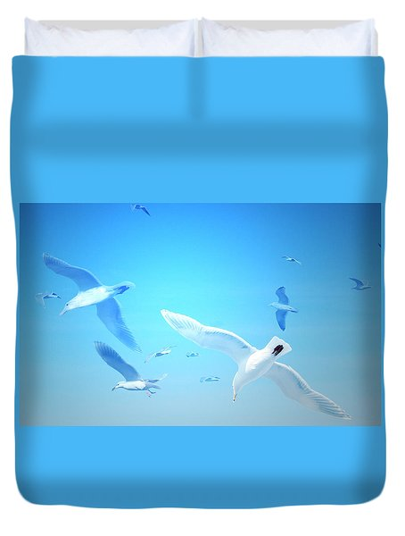 Duvet Cover featuring the digital art Gulls In Flight by Michele Cornelius