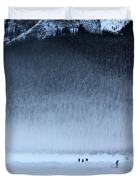 Duvet Cover featuring the photograph Hockey On Lake Louise by Alyce Taylor
