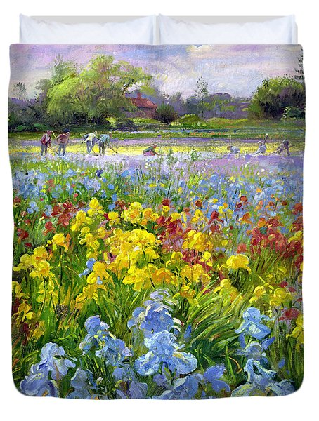 Hoeing Team And Iris Fields Duvet Cover by Timothy Easton