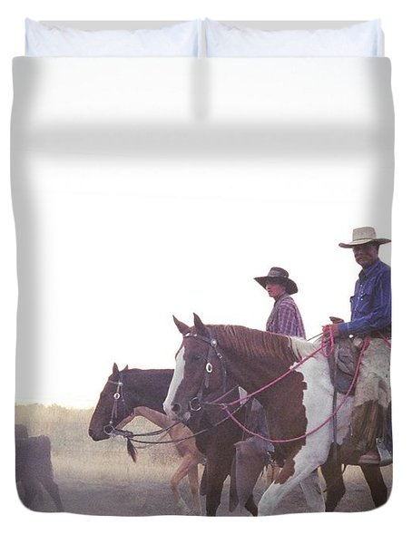 In The Saddle Duvet Cover by Peter Mooyman
