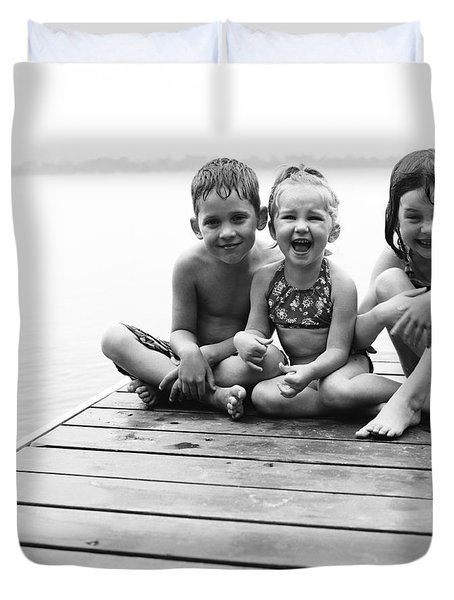 Kids Sitting On Dock Duvet Cover by Michelle Quance