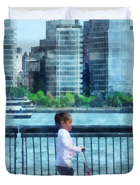 Little Girl On Scooter By Manhattan Skyline Duvet Cover by Susan Savad