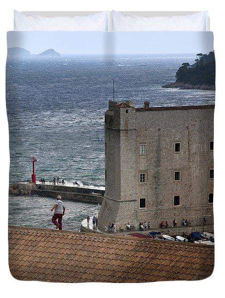 Man On The Roof In Dubrovnik Duvet Cover by Madeline Ellis