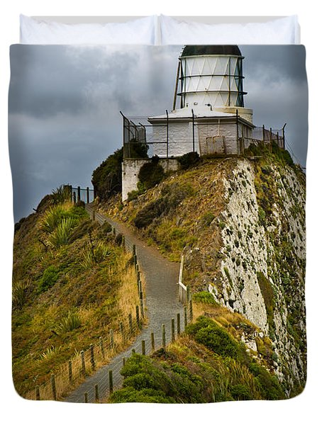 Nugget Point Light House And Dark Clouds In The Sky Duvet Cover