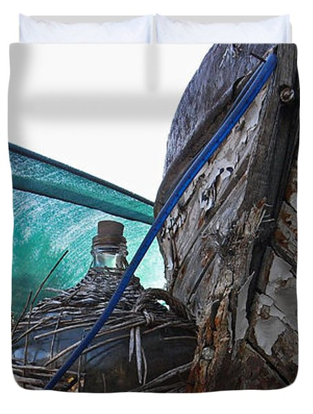Duvet Cover featuring the photograph Old Boat And Flagons by Andy Prendy