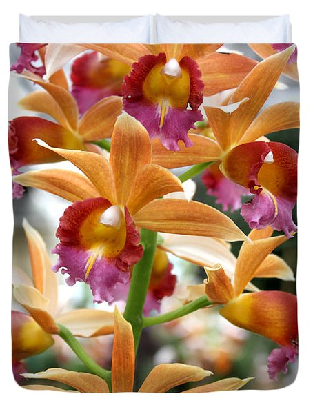 Duvet Cover featuring the photograph Orange Orchids by Debbie Hart