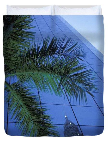 Palm Tree And Reflection Of Petronas Duvet Cover by Axiom Photographic
