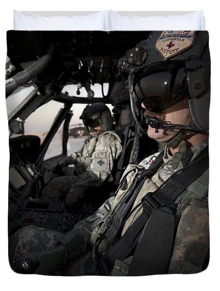 Pilot In The Cockpit Of A Uh-60l Duvet Cover by Terry Moore